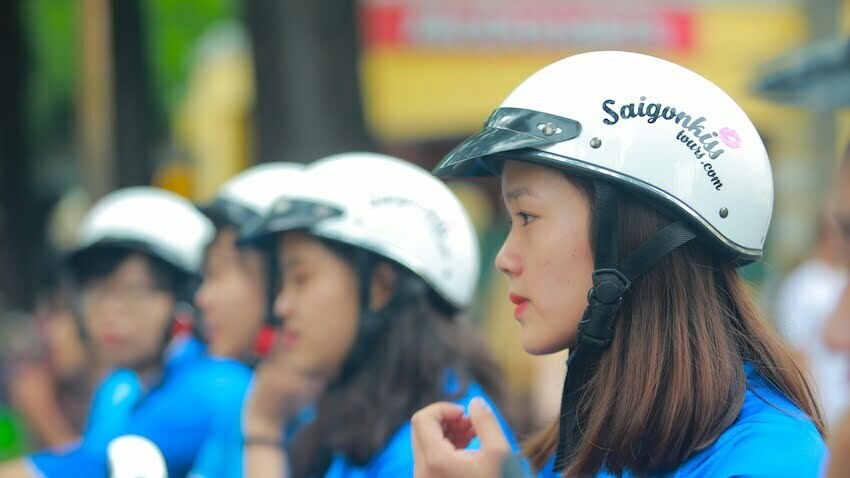 female drivers with Saigon Kiss Tours helmets